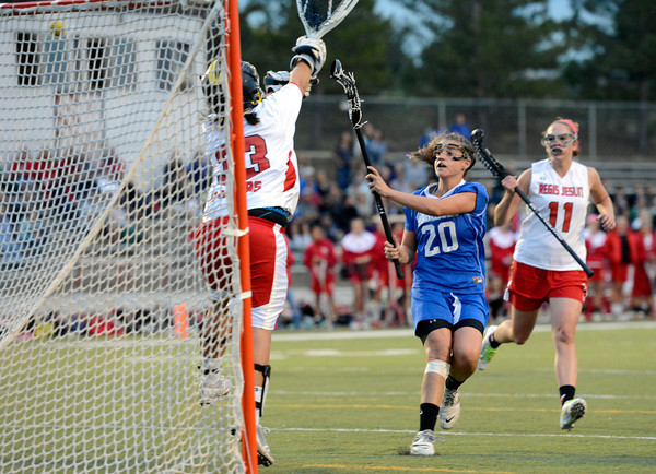 "Centaurus High School's Emma Lazaroff shoots a goal over Regis Jesuit High School goalkeeper Emily Smith during a lacrosse game on Wednesday, May 16, at Regis Jesuit High School oin Aurora. Centaurus won the game 14-8. For more photos of the game go to  <a href=""http://www.dailycamera.com"">http://www.dailycamera.com</a><br /> Jeremy Papasso/ Camera"