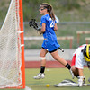 """Centaurus High School's Emma Lazaroff trots past Regis Jesuit High School goalkeeper Emily Smith after scoring a goal during a lacrosse game on Wednesday, May 16, at Regis Jesuit High School oin Aurora. Centaurus won the game 14-8. For more photos of the game go to  <a href=""""http://www.dailycamera.com"""">http://www.dailycamera.com</a><br /> Jeremy Papasso/ Camera"""