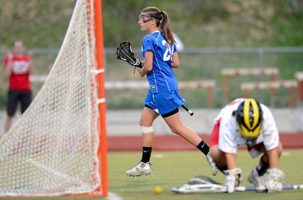 "Centaurus High School's Emma Lazaroff trots past Regis Jesuit High School goalkeeper Emily Smith after scoring a goal during a lacrosse game on Wednesday, May 16, at Regis Jesuit High School oin Aurora. Centaurus won the game 14-8. For more photos of the game go to  <a href=""http://www.dailycamera.com"">http://www.dailycamera.com</a><br /> Jeremy Papasso/ Camera"