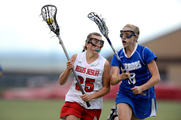 "Centaurus High School's Sarah Brown looks to steal the ball from Regis Jesuit High School's Erin Sungelo during a lacrosse game on Wednesday, May 16, at Regis Jesuit High School oin Aurora. Centaurus won the game 14-8. For more photos of the game go to  <a href=""http://www.dailycamera.com"">http://www.dailycamera.com</a><br /> Jeremy Papasso/ Camera"