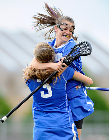 """Centaurus High School's Emma Lazaroff jumps into the arms of Sarah Brown after scoring a goal against Regis Jesuit High School during a lacrosse game on Wednesday, May 16, at Regis Jesuit High School oin Aurora. Centaurus won the game 14-8. For more photos of the game go to  <a href=""""http://www.dailycamera.com"""">http://www.dailycamera.com</a><br /> Jeremy Papasso/ Camera"""