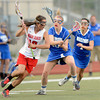 """Centaurus High School's Katherine Burns tries to steal the ball from Regis Jesuit High School's Ryleigh Mynatt during a lacrosse game on Wednesday, May 16, at Regis Jesuit High School oin Aurora. Centaurus won the game 14-8. For more photos of the game go to  <a href=""""http://www.dailycamera.com"""">http://www.dailycamera.com</a><br /> Jeremy Papasso/ Camera"""