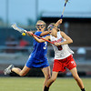 "Centaurus High School's Sarah Brown knocks the ball out of the hands of Regis Jesuit High School's Kat Blumhardt during a lacrosse game on Wednesday, May 16, at Regis Jesuit High School oin Aurora. Centaurus won the game 14-8. For more photos of the game go to  <a href=""http://www.dailycamera.com"">http://www.dailycamera.com</a><br /> Jeremy Papasso/ Camera"