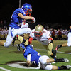 "Centaurus High School's Matthew Buchler hurdles his teammate and Skyline's Eric Caballero while returning a kick off during a game against Skyline High School on Friday, Sept. 28, at Centaurus High School in Lafayette. For more photos of the game go to  <a href=""http://www.dailycamera.com"">http://www.dailycamera.com</a><br /> Jeremy Papasso/ Camera"