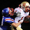 "Skyline High School's Seth Thomas tries to avoid a tackle by Matthew Buchler during a game on Friday, Sept. 28, at Centaurus High School in Lafayette. For more photos of the game go to  <a href=""http://www.dailycamera.com"">http://www.dailycamera.com</a><br /> Jeremy Papasso/ Camera"