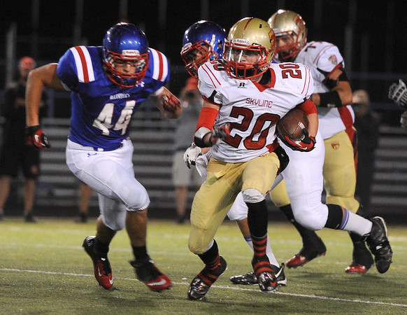 "Skyline High School's Israel Valdez runs the ball past Centaurus High School's Derek French during a game on Friday, Sept. 28, at Centaurus High School in Lafayette. For more photos of the game go to  <a href=""http://www.dailycamera.com"">http://www.dailycamera.com</a><br /> Jeremy Papasso/ Camera"