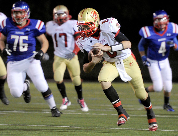 """High School quarterback Garret Angstead rushes the ball during a game against Skyline High School on Friday, Sept. 28, at Centaurus High School in Lafayette. For more photos of the game go to  <a href=""""http://www.dailycamera.com"""">http://www.dailycamera.com</a><br /> Jeremy Papasso/ Camera"""