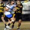 "Centaurus High School's Emma Lazaroff shoots a goal past Thompson Valley's Lanie Matsumoto, No. 14, during a girls lacrosse game at Centaurus High School in Lafayette. For more photos of the game go to  <a href=""http://www.dailycamera.com"">http://www.dailycamera.com</a><br /> Jeremy Papasso/ Camera"