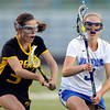 "Centaurus High School's Sarah Brown pushes upfield past Thompson Valley's Mackie Stuart during a girls lacrosse game at Centaurus High School in Lafayette. For more photos of the game go to  <a href=""http://www.dailycamera.com"">http://www.dailycamera.com</a><br /> Jeremy Papasso/ Camera"
