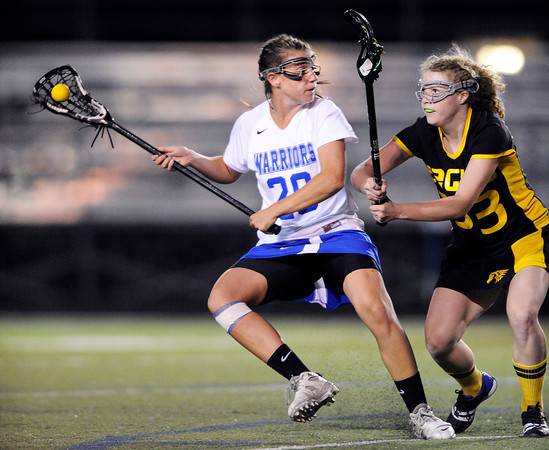 "Centaurus High School's Emma Lazaroff squares off for a shot over Thompson Valley's Raychi Reger during a girls lacrosse game at Centaurus High School in Lafayette. For more photos of the game go to  <a href=""http://www.dailycamera.com"">http://www.dailycamera.com</a><br /> Jeremy Papasso/ Camera"