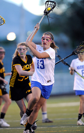 "Centaurus High School's Carley Dvorak takes a shot on goal during a girls lacrosse game against Thompson Valley at Centaurus High School in Lafayette. For more photos of the game go to  <a href=""http://www.dailycamera.com"">http://www.dailycamera.com</a><br /> Jeremy Papasso/ Camera"