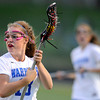 "Centaurus High School's Carley Dvorak drives upfield during a girls lacrosse game against Thompson Valley High School at Centaurus High School in Lafayette. For more photos of the game go to  <a href=""http://www.dailycamera.com"">http://www.dailycamera.com</a><br /> Jeremy Papasso/ Camera"