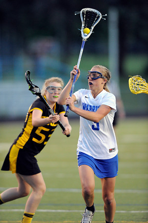 "Centaurus High School's Sarah Brown passes the ball over Thompson Valley's Raychi Reger during a girls lacrosse game at Centaurus High School in Lafayette. For more photos of the game go to  <a href=""http://www.dailycamera.com"">http://www.dailycamera.com</a><br /> Jeremy Papasso/ Camera"