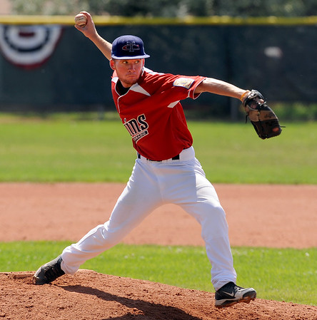 """Patrick Martein (5) of the Longmont Twins, pitches against the Warriors on Thursday.<br /> For more photos of the game, go to  <a href=""""http://www.dailycamera.com"""">http://www.dailycamera.com</a>.<br /> Cliff Grassmick / July 12, 2012"""