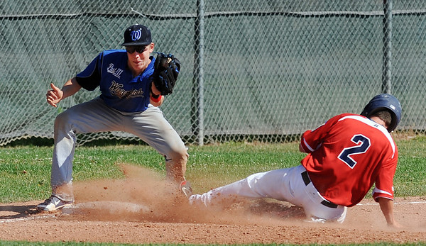 "Adam Reigle (2) of the Longmont Twins, tries to get to third before the tag by Brody Jaskul of the Warriors.<br /> For more photos of the game, go to  <a href=""http://www.dailycamera.com"">http://www.dailycamera.com</a>.<br /> Cliff Grassmick / July 12, 2012"