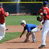 """Ryan Norton of the Warriors gets caught in a run down against the Longmont Twins.<br /> For more photos of the game, go to  <a href=""""http://www.dailycamera.com"""">http://www.dailycamera.com</a>.<br /> Cliff Grassmick / July 12, 2012"""