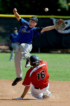 "Ryan Norton, top, of the Warriors, attempts to catch a high throw as Reilly Mau of the Longmont Twins is safe at second.<br /> For more photos of the game, go to  <a href=""http://www.dailycamera.com"">http://www.dailycamera.com</a>.<br /> Cliff Grassmick / July 12, 2012"