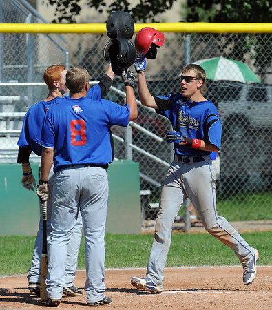 "Brody Jaskul, right, of the Warriors celebrates a 2-run homerun with teammates against the Longmont Twins on Thursday.<br /> For more photos of the game, go to  <a href=""http://www.dailycamera.com"">http://www.dailycamera.com</a>.<br /> Cliff Grassmick / July 12, 2012"