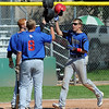 """Brody Jaskul, right, of the Warriors celebrates a 2-run homerun with teammates against the Longmont Twins on Thursday.<br /> For more photos of the game, go to  <a href=""""http://www.dailycamera.com"""">http://www.dailycamera.com</a>.<br /> Cliff Grassmick / July 12, 2012"""