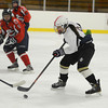 RYAN HUTTON/ Staff photo. <br /> HPNA's Kim Carroll (9) carries the puck toward Central Catholic's goal during Tuesday night's game in Haverhill.