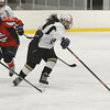RYAN HUTTON/ Staff photo. <br /> HPNA's Kim Carroll (9) snags the puck from Central Catholic's defenders during Tuesday night's game in Haverhill. during Tuesday night's game in Haverhill.
