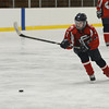 RYAN HUTTON/ Staff photo. <br /> Central Catholic's Lexi Stanisewski (2) goes for an open puck during Tuesday night's game in Haverhill.