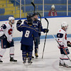 Malden Catholic's Tyler Sifferlen, facing, is congratulated by teammates after scoring a goal during the third period. Photo by Mary Schwalm