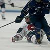 Central Catholic's Lloyd Hayes, falls to ice as Malden Catholic's Jake Witkowski (8) skates on. Photo by Mary Schwalm