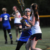 CARL RUSSO/Staff photo. Central Catholic defeated Methuen 15-5 in Girls Lacrosse Division I North First Round Tuesday night. Methuen's Jamie Moynihan keeps her eye on the ball as she covers Central's Emily Frocione. 5/27/2104.