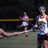 CARL RUSSO/Staff photo. Central Catholic defeated Methuen 15-5 in Girls Lacrosse Division I North First Round Tuesday night. Central's senior captain, Ashley Masucci passes the ball to her teammate. 5/27/2104.