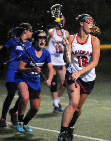 CARL RUSSO/Staff photo. Central Catholic defeated Methuen 15-5 in Girls Lacrosse Division I North First Round Tuesday night. Central's Alicia Bilsky, 18, keeps the ball moving. 5/27/2104.