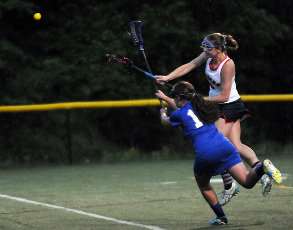 CARL RUSSO/Staff photo. Central Catholic defeated Methuen 15-5 in Girls Lacrosse Division I North First Round Tuesday night. Central's senior captain, Ashley Masucci shoots long and scores as Methuen's Nicole Hering tries to block her shot. 5/27/2104.