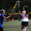 CARL RUSSO/Staff photo. Central Catholic defeated Methuen 15-5 in Girls Lacrosse Division I North First Round Tuesday night. Methuen's Jamie Moynihan, left, keeps her eye on the ball as she covers Central's Emily Frocione. 5/27/2104.