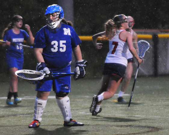 CARL RUSSO/Staff photo. Central Catholic defeated Methuen 15-5 in Girls Lacrosse Division I North First Round Tuesday night. Central's senior captain, Steph May, 7, celebrates her goal to the dismay of Methuen's goalie, Sophia Tiar. 5/27/2104.
