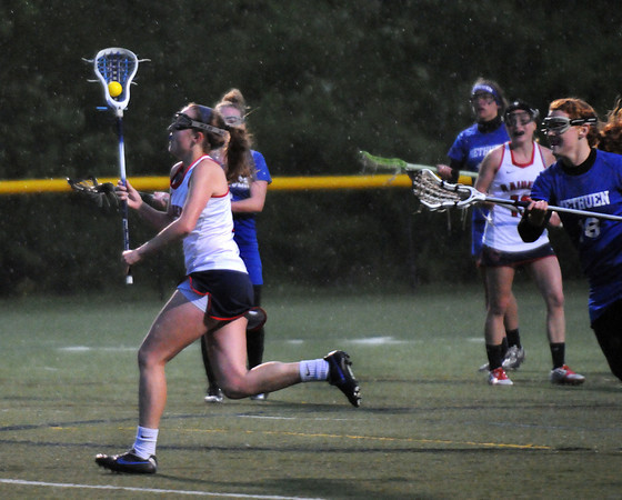 CARL RUSSO/Staff photo. Central Catholic defeated Methuen 15-5 in Girls Lacrosse Division I North First Round Tuesday night. Central's senior captain, Steph May races across the field. 5/27/2104.