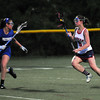 CARL RUSSO/Staff photo. Central Catholic defeated Methuen 15-5 in Girls Lacrosse Division I North First Round Tuesday night. Methuen's Aryanna Poirier, left, goes face to face with Central's senior captain, Ashley Masucci as they race across the field. 5/27/2104.
