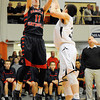 Central's Tyler Nelson shoots over the Prep's Max Burt at the Raider's game.  Photo by Paul Bilodeau.