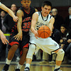 St John's Prep's Max Burt almost has the ball taken away by Central's Alex Santos at the Raider's game against St. John's Prep during the Div. 1 North semifinal game at Beverly High School.  Photo by Paul Bilodeau.