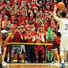 The Central Catholic Crazies taunt St. John's Prep's Max Burt.<br />  Photo by Paul Bilodeau.