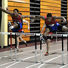 CARL RUSSO/Staff photo. Central Catholic boys defeated North Andover in a track meet held at North Andover high Wednesday night. Central's Jeremy Zannini (right) captured first place with a time of 8.0 seconds in the 55 meter hurdles while his teammate, D'Andre Drummond-Mayrie (left) captured second place at 8.2 seconds. 12/12/2012.