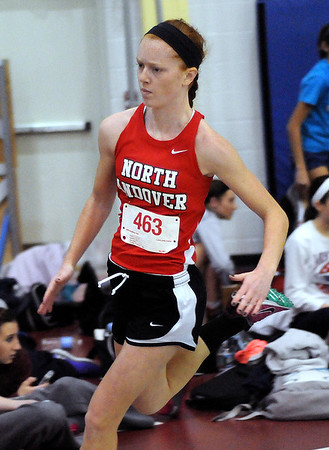 CARL RUSSO/Staff photo. North Andover girls defeated Central Catholic 47-39 in a track meet held at North Andover high Wednesday night. North Andover junior, Erin Kelley competes in the 300 meters race. 12/12/2012.