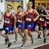 CARL RUSSO/Staff photo. Central Catholic boys defeated North Andover in a track meet held at North Andover high Wednesday night. Central Catholic runners, from left, Nick Bowden, Andrew Devaney and Julian Pryde compete in the two mile race against North Andover's Joe McManus and other runners. Bowden captured first place, McManus took second and Devaney came in third. 12/12/2012.