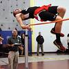 CARL RUSSO/Staff photo. Central Catholic boys defeated North Andover in a track meet held at North Andover high Wednesday night. North Andover's Patrick Irwin competes in the high jump.  12/12/2012.