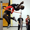 CARL RUSSO/Staff photo. Central Catholic boys defeated North Andover in a track meet held at North Andover high Wednesday night. North Andover's Ahamdi Ogwuru captured first place in the high jump clearing the bar at 6 feet 2 inches. 12/12/2012.