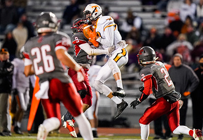 Tyrone WR Damon Gripp hauls in a pass in traffic against Central Saturday night at Mansion Park.  Josh Biesinger (9) in coverage.