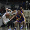 Jun Kent Manzo looks to pass the ball
