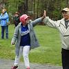 Jillian Beurbe high fives 1st base coach Karen Black
