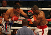 Super Welterweights Carlos Quintana (Red, White, Blue trunks) and DeAndre Latimore (White, Red trunks) battled until a sixth round knockout by Quintana clinched an early victory.