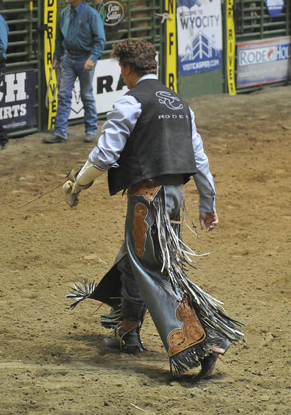 Bud Denega | The Sheridan Press<br /> Sheridan College's Chance Ames walks off after riding Bunny Girl in the short round of bareback riding during the College National Finals Rodeo at the Casper Events Center Saturday, June 16, 2018.