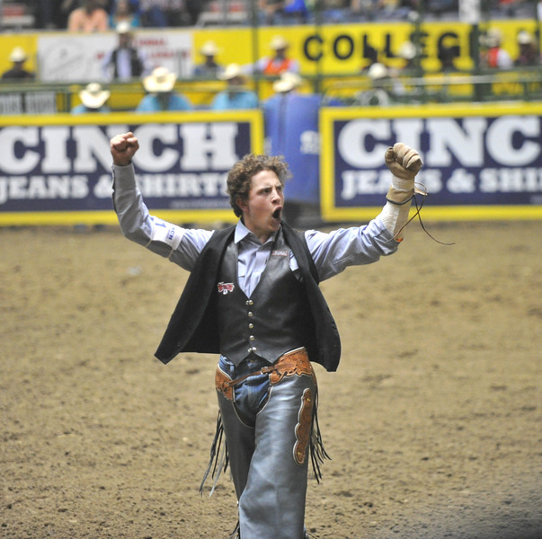 Bud Denega | The Sheridan Press<br /> Sheridan College's Chance Ames pumps up the crowd after riding Bunny Girl in the short round of bareback riding during the College National Finals Rodeo at the Casper Events Center Saturday, June 16, 2018.